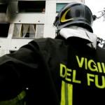 Palazzina in fiamme a Brescia