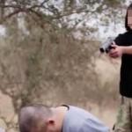 Isis video bambino prigionieri pistola