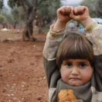 Siria Bambina si arrende al fotografo