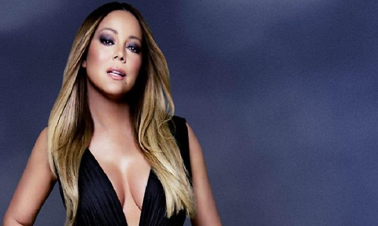 Mariah Carey in reggicalze al club