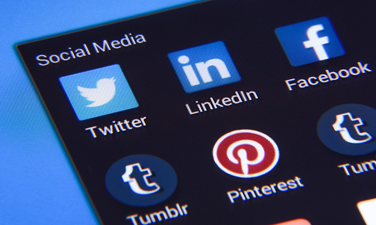 Krynica Poland - November 03, 2016 . Popular social media app isons: Twitter, LinkedIn, Facebook and other on smart phone screen close up.